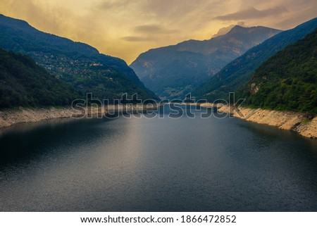 Photo of  The lake Lago di Vogorno in canton Ticino, Switzerland. This lake is a reservoir located on the Verzasca river and formed by the Verzasca Dam.