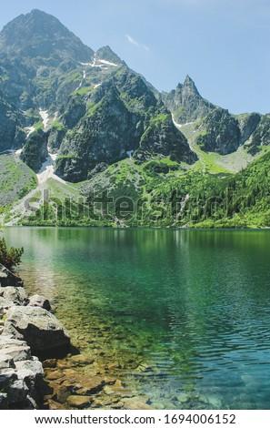 The lake Morskie Oko or Eye of the Sea. Western Carpathian mountains. The Tatra National Park in the Rybi Potok (the Fish Brook) Valley, Zakopane, Poland. Stock fotó ©