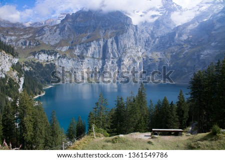 The lake oeschinen above Kandersteg in the swiss alps has a wonderful contrasty look to offer. The blue water, the green trees and the Grey rocks in the background Play a gorgeous Symphony. #1361549786