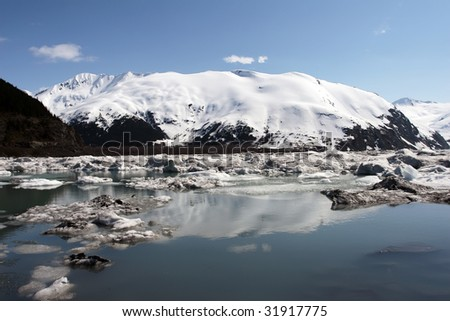 The lake of Portage Glacier is now where the glacier used to be a few years back. Portage Glacier is located in Alaska and close to Anchorage.