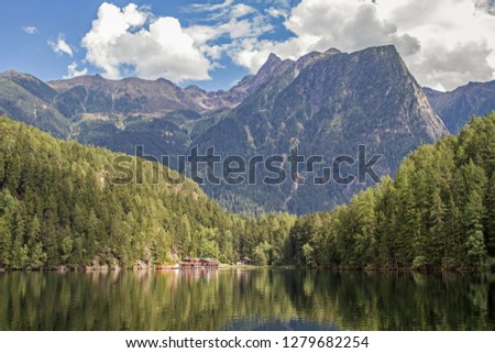 The lake Piburg an idyllic mountain lake in the Ötztal has been elevated to a natural monument and belongs because of its rare plants and animals to the conservation area. #1279682254