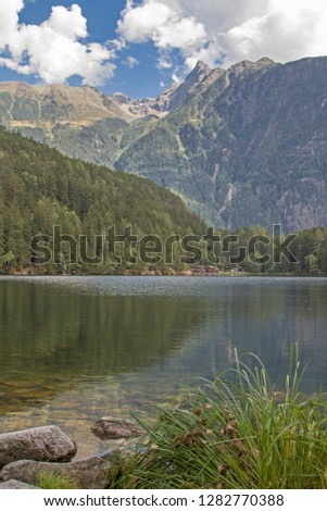 The lake Piburg an idyllic mountain lake in the Ötztal has been elevated to a natural monument and belongs because of its rare plants and animals to the conservation area. #1282770388
