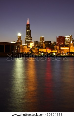 The lakefront and Chicago skyline with the Sears Tower from pier along Lake Michigan. - stock photo