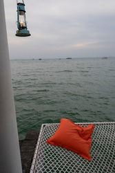 The lamp of lights the blue sea in the evening