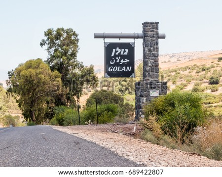 The landmark on the roadside marking the beginning of the Golan Heights in Israel #689422807