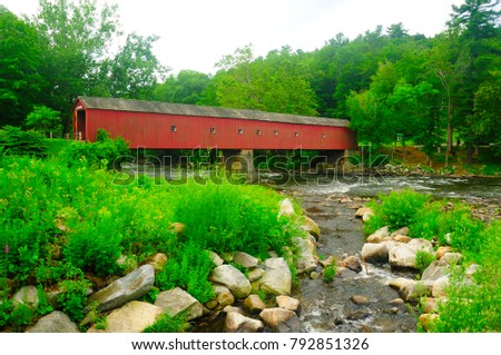 The landmark West Cornwall covered bridge over the Housatonic River in West Cornwall Connecticut in the summer.   #792851326