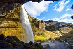 the landscape around the hidden waterfall named Kvernufoss waterfall