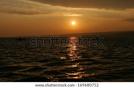 the landscape is beautiful sunset over the water
