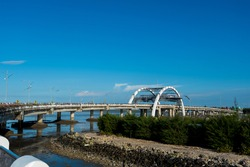 The landscape of architecture or construction of a bridge across the sea as a means of easing transportation congestion as well as a tourism icon that can have an impact on economic growth