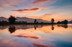 The landscape of Lam Taphoen reservoir at sunrise in Suphan Buri province, Thailand