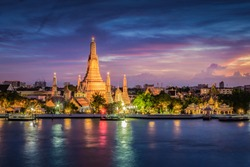 The landscape photo of Wat Arun (The temple of dawn) at twilight time. Wat Arun temple is top tourist destination in Bangkok,  located along the Chao Phraya river in Bangkok, Thailand