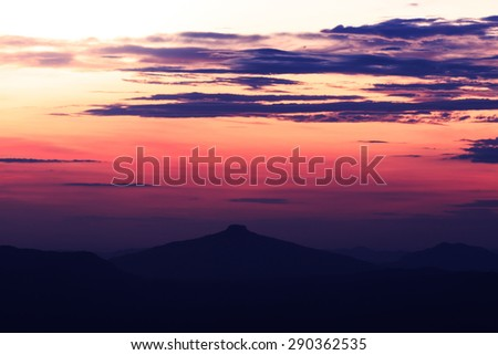The landscape photo, silhouette of mountain and sky at sunrise/ sunset viewpoint
