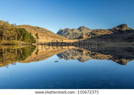 The Langale Pikes and Side Pike reflected in Blea Tarn, Little Langdale