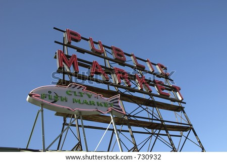 The large neon sign that says Public Market at the pike place market seattle