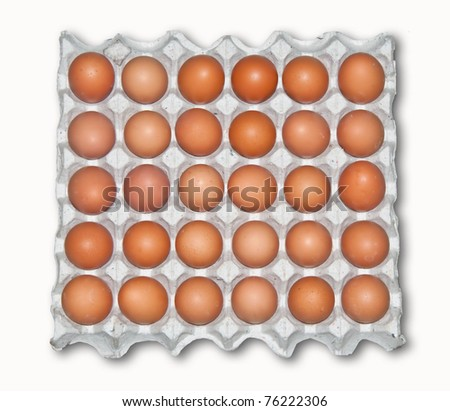 The Large tray of fresh eggs isolated on white background