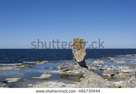 The largest field of sea stacks in Sweden, Digerhuvud, on Faro, Gotland in the Baltic sea. Natural and imaginative sculptures, a geological phenomenon since millions of years back. #486730444