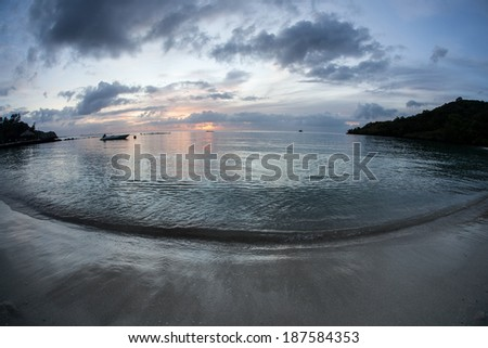 The last light of day illuminates a beach in the Republic of Palau. This popular destination is famous for its spectacular scenery, scuba diving, and snorkeling. #187584353