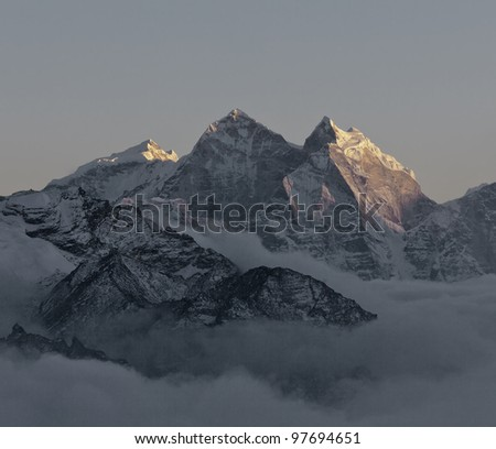 The last rays of the sun on the tops of the mountains in the area of the Everest - Nepal