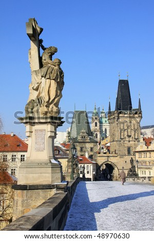 The late Snow in March Prague â?? view on St. Nicholas' Cathedral with Charles Bridge Tower