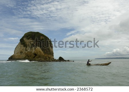 the latin man in boat on pacific. ecuador. south america