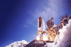 The launch of the space shuttle against the sky, fire and smoke. Elements of this image were furnished by NASA.