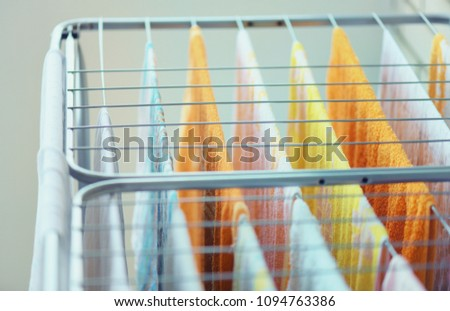 The laundry hangs on the dryer. Drying clothes after washing. #1094763386