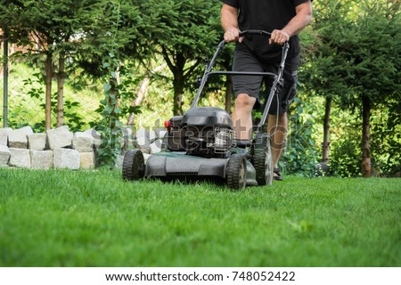 The lawn is mown with the lawn mower #748052422