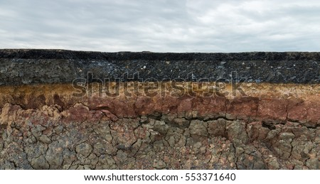 The layer of asphalt road with soil and rock. Un-focus image. Stock photo ©