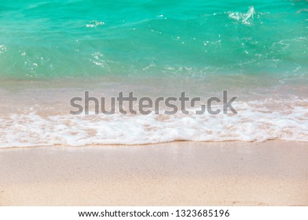 The layers of soft wave on sandy beach. Background of travel in summer #1323685196