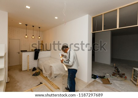 The layout of rooms and rooms in a new building, a view of two rooms and a partition between them #1187297689