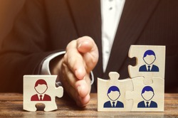 The leader separates the puzzle with the image of the employee. The concept of personnel management in the company. Dismissing an employees from a team. Demotion. Bad worker. Staff cuts