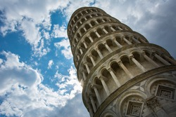 The Leaning Tower of Pisa, Italy, famous for its tilt, with the cloudy sky. A bell tower of the nearby Pisa Cathedral, it is one of the most popular tourist attractions in Tuscany and even Italy