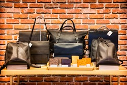 The leather bag on the shelf in store window at thailand.