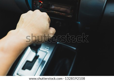 Hand on automatic gear shift, Man hand shifting an automatic car