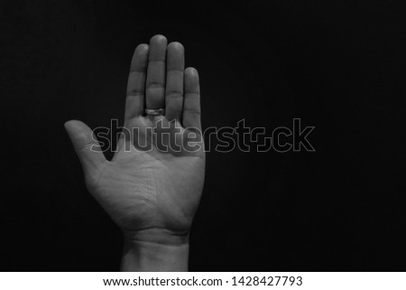 The left palm of the background is black. #1428427793