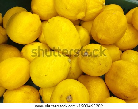 The lemon is a species of small evergreen tree. the juice of the lemon is about 5% to 6% citric acid, with a pH of around 2.2, giving it a sour taste.