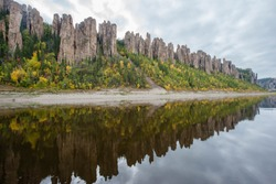 The Lena Pillars is a geological formation and a natural park of the same name in Russia, on the banks of the Lena River. Located in Khangalassky district of Yakutia, 104 km from the city of Pokrovsk.