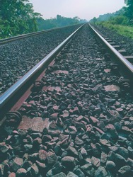 The length of the railway track- metal railway landscape background and the rock