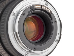 The lens of modern digital camera, rear view of the lens. Isolated on white background.