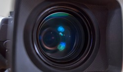 the lens of the television camera close-up