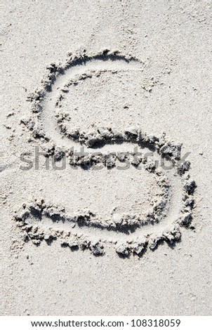 The letter S of the alphabet writing on the sand beach