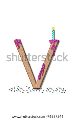 The letter V, from the alphabet set Happy Birthday, is tan with cake-like textured fill.  Letter is iced with pink frosting and sprinkled with tiny candies.  Candle sets in frosting on top of letter.