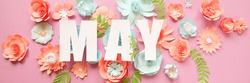 The lettering may, made of paper flowers. Hello, may. Concept of flowering, spring