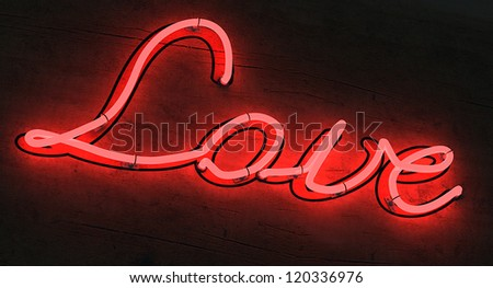 The letters LOVE lighted up in red neon colors