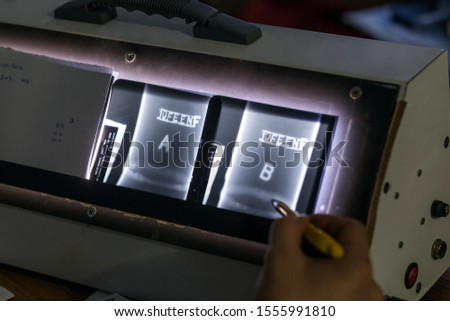 The level 2 inspector evaluation radiographs of the steel pipe welds. The writes on the radiograph films are penetrameters according to international standards. Its mean precision measurement of film. Stock photo ©