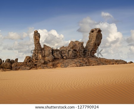 The Libyan desert - a fantastic place for travelers and photographers. Rocks of an unusual form, beautiful structure of dense yellow sand, dune of the huge sizes and deep sky of Sahara.