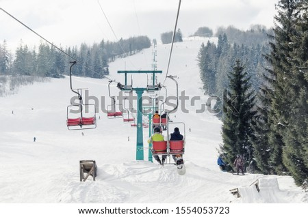 The lifts at the ski resort, the skiers lift up on the lift