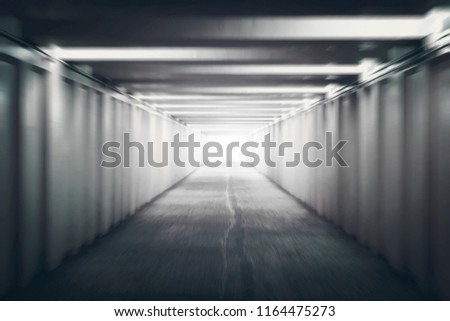 The Light at the End of the Tunnel. Pedestrian crossing under the road. underground passage. motion blur. concept of hope, or the afterlife. after death, next world #1164475273