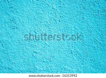The light blue background, plaster is rough cement of a wall