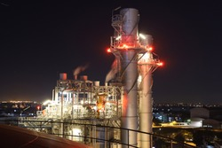 The light of the power plant and the city at night